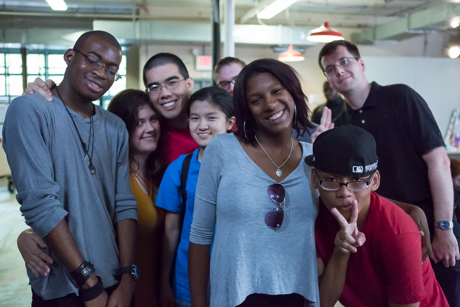 Group of young adults with disabilities bunched together and smiling