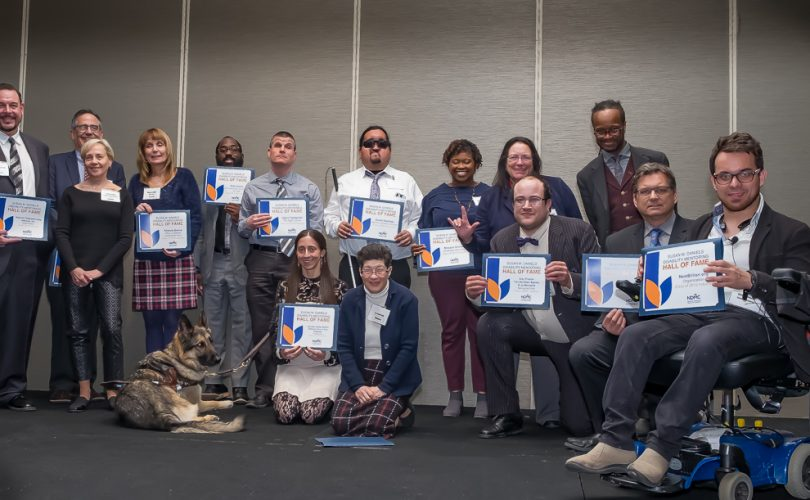 15 inductees into the Disability Mentoring Hall of Fame posing with their certificates.