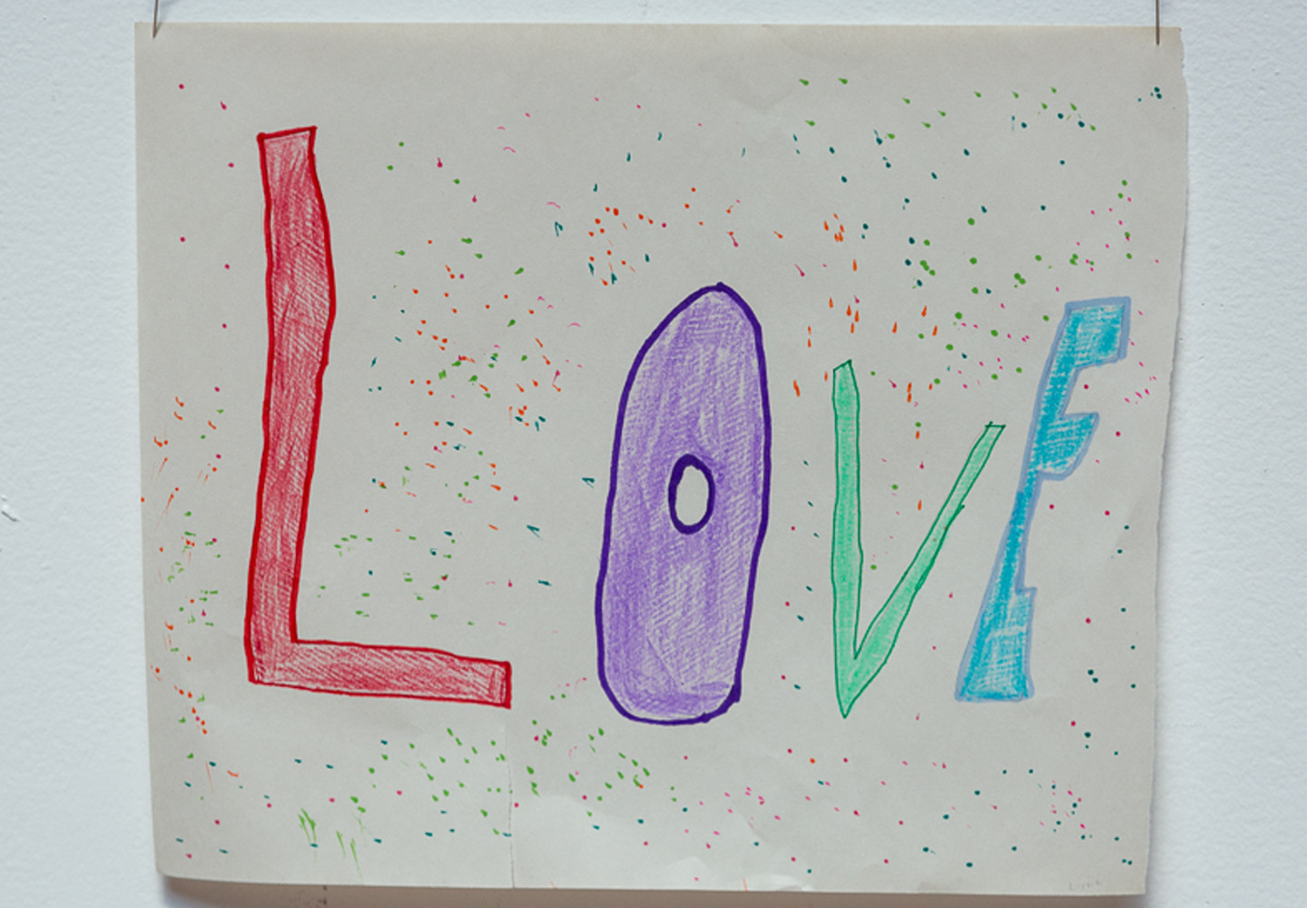 A drawn sign saying 'Love'